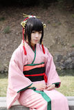 Young japanese cosplayer. Anime festival 2011, Participant at cosplay event at japanese riturin garden park, Nov 27, 2011: Anime fan dressed Royalty Free Stock Photos