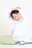 Young Japanese female doctor takes a rest Stock Photos