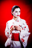 Young Japanese Geisha Girl. A young caucasian woman dressed as a Japanese Geisha girl Royalty Free Stock Photography