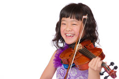 Young Japanese Girl Portrait with Violin. A portrait of a cute, happy and young Japanese girl in a purple dress on a white background with a violin royalty free stock images