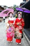 Young Japanese girls dressed in geisha`s custom taking a walk in the stone-paved roads of Ninenzaka and Sannenzaka. Kyoto, Japan-August, 11th of 2017: Young Royalty Free Stock Image