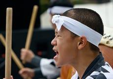 Young Japanese male performing taiko. Miyama, Kagoshima, Japan, November 1, 2008. A closeup profile of the face of a young Japanese male as he performs taiko at royalty free stock image