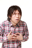 Young Japanese man heart attack Royalty Free Stock Image