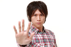 Young Japanese man making stop gesture Royalty Free Stock Photography