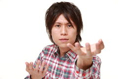 Young Japanese man with supernatural power Stock Image