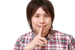 Young Japanese man whith silence gestures Stock Photos