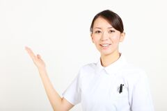 Young Japanese nurse explains Royalty Free Stock Images