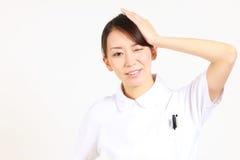 Young Japanese nurse reflects Stock Photos