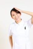 Young Japanese nurse reflects Stock Photo