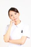 Young Japanese nurse thinks about something Stock Image