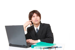 Young Japanese office worker thinks about something . Studio shot of young Japanese man on white background royalty free stock photos