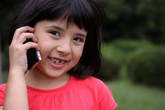 Young Japanese-Russian girl laughing on the phone Royalty Free Stock Photos