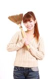 Young Japanese woman with a broom Stock Photos