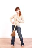 Young Japanese woman with a broom Royalty Free Stock Photography