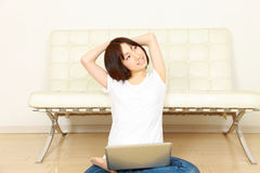Young Japanese woman with computer Stock Photography