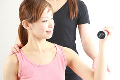 Young Japanese woman doing dumbbell exercise Royalty Free Stock Photography