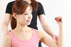 Young Japanese woman doing dumbbell exercise Royalty Free Stock Image