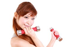 Young Japanese woman doing dumbbell exercises Stock Photography
