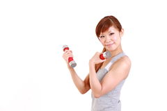 Young Japanese woman doing dumbbell exercises Royalty Free Stock Photo