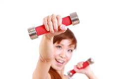 Young Japanese woman doing dumbbell exercises Royalty Free Stock Photography