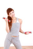 Young Japanese woman doing dumbbell exercises Stock Photo