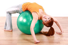 Young Japanese woman doing exercise with fitness ball Royalty Free Stock Photography