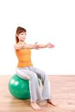 Young Japanese woman doing exercise with fitness ball Stock Image