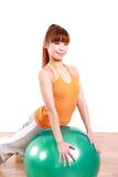 Young Japanese woman doing exercise with fitness ball Stock Photography