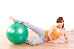 Young Japanese woman doing exercise with fitness ball Stock Photos