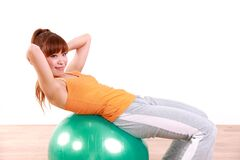 Young Japanese woman doing exercise with fitness ball Stock Photo