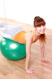 Young Japanese woman doing exercise with fitness ball Royalty Free Stock Images