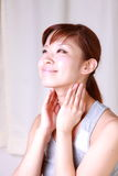 Young Japanese woman doing a lymph node massage  Stock Images