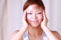 Young Japanese woman doing a self face massage  Stock Photos