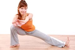 Young Japanese woman doing stretch Stock Images