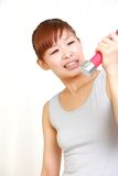 Young Japanese woman doing tight training Royalty Free Stock Photography