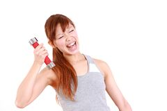 Young Japanese woman doing tight training Royalty Free Stock Image