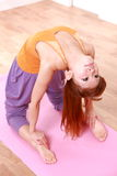 Young Japanese woman doing YOGA camel pose Stock Photo