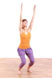 Young Japanese Woman Doing YOGA chair pose Royalty Free Stock Photography