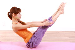 Young Japanese woman doing YOGA full boat pose Stock Photo
