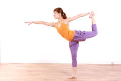 Young Japanese Woman Doing YOGA lord of the dance pose Stock Photo