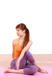 Young Japanese woman doing YOGA plow pose Royalty Free Stock Photos