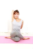 Young Japanese woman doing YOGA pose Stock Photography