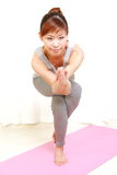 Young Japanese woman doing YOGA pose Royalty Free Stock Photos