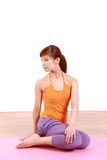 Young Japanese woman doing YOGA sage twist Royalty Free Stock Image