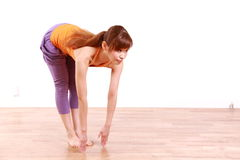 Young Japanese Woman Doing YOGA standing forward bend pose Stock Photo