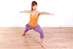 Young Japanese Woman Doing YOGA warrior 2 pose Royalty Free Stock Photo