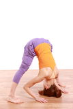 Young Japanese Woman Doing YOGA wide legged forward bend pose Royalty Free Stock Photo