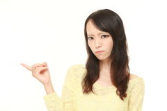 Young Japanese woman doubting Stock Photos