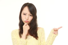 Young Japanese woman doubting Royalty Free Stock Images