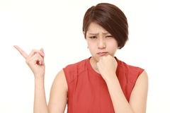 Young Japanese woman doubting Stock Photo